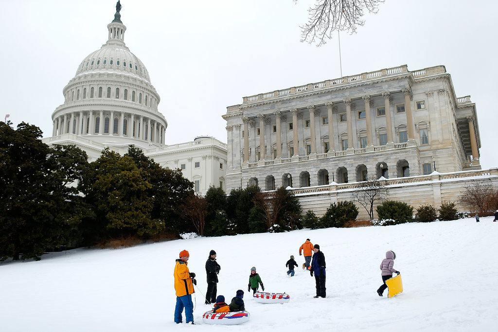 Parts of DC were hit with up to 12 inches of snow, and some people took advantage of the heavy snowfall by sledding near the US Capitol.