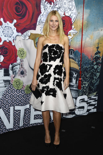 Paltrow got into the holiday spirit, blooming in a strapless, pale pink Prada detailed with black bead-and-sequin embroidery in Paris.