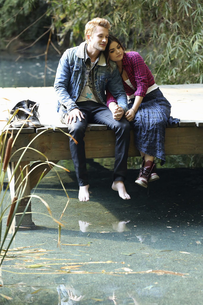 Aria and her new beau hold hands on a dock. Source: ABC Family