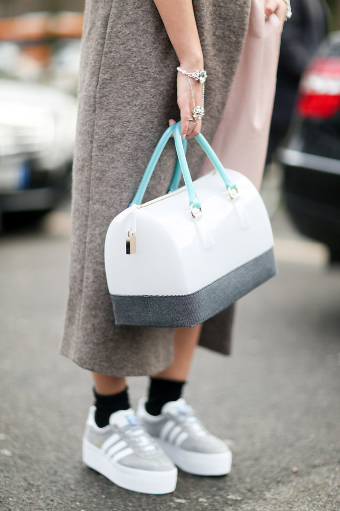 We love the no-fuss feel of this bag and these cool kicks.