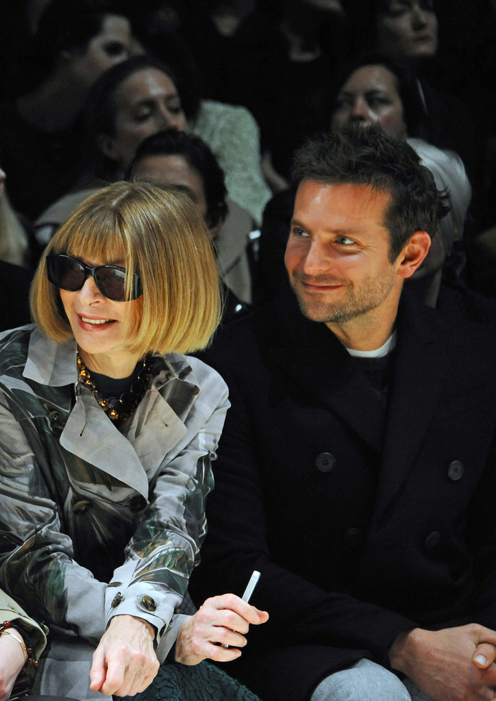 Bradley Cooper supported his girlfriend, Suki Waterhouse, as she modeled at London Fashion Week, sitting from row with Vogue editor Anna Wintour.