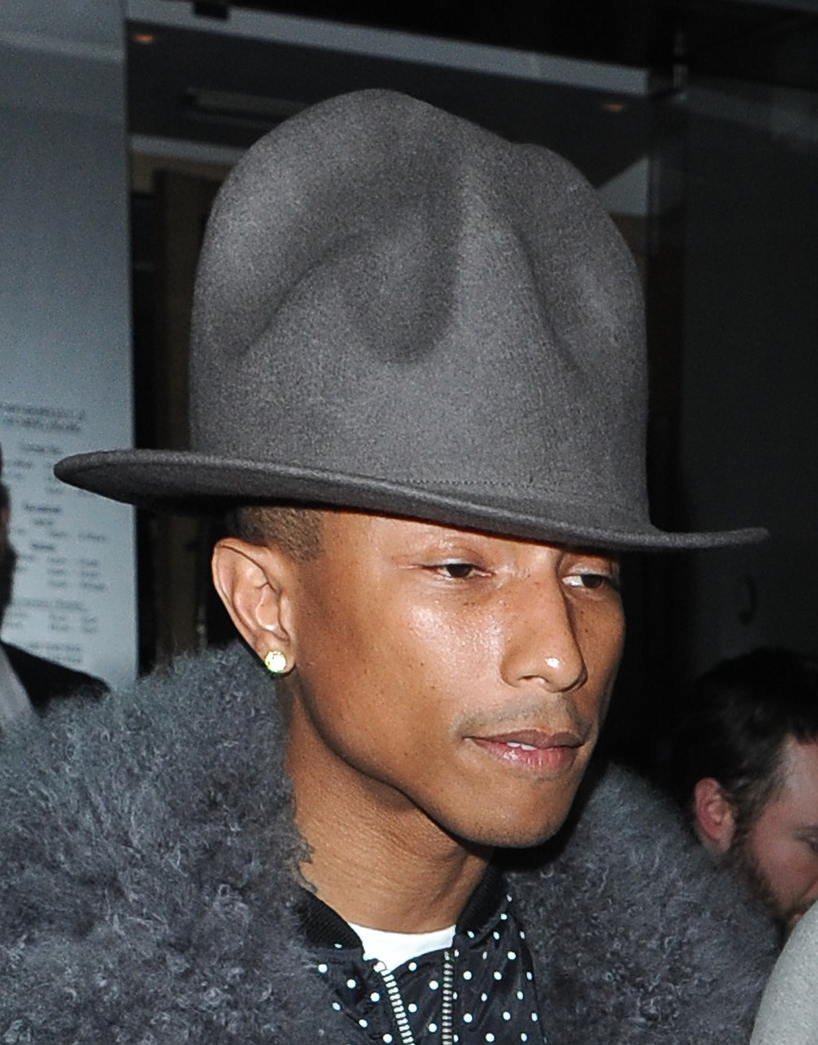 Pharrell was spotted out in London with his hat at the beginning of the month. The two switched up their look with matching shades of gray.
