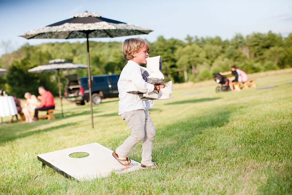 They hand-made all the signs and lawn games.  Source: Evangeline Lane Photography