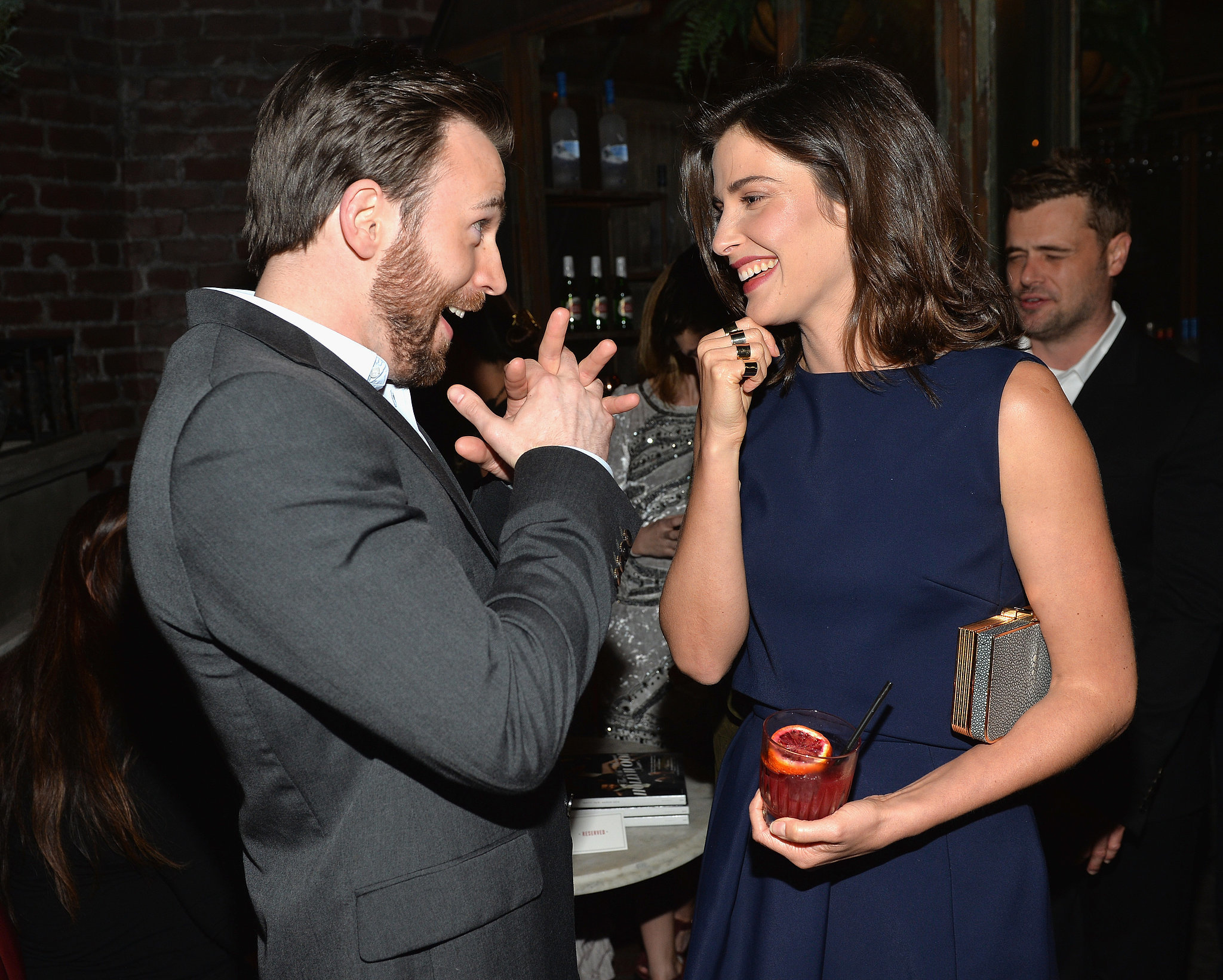 Chris Evans made Cobie Smulders laugh inside Vanity Fair's pre-Oscars party on Tuesday.