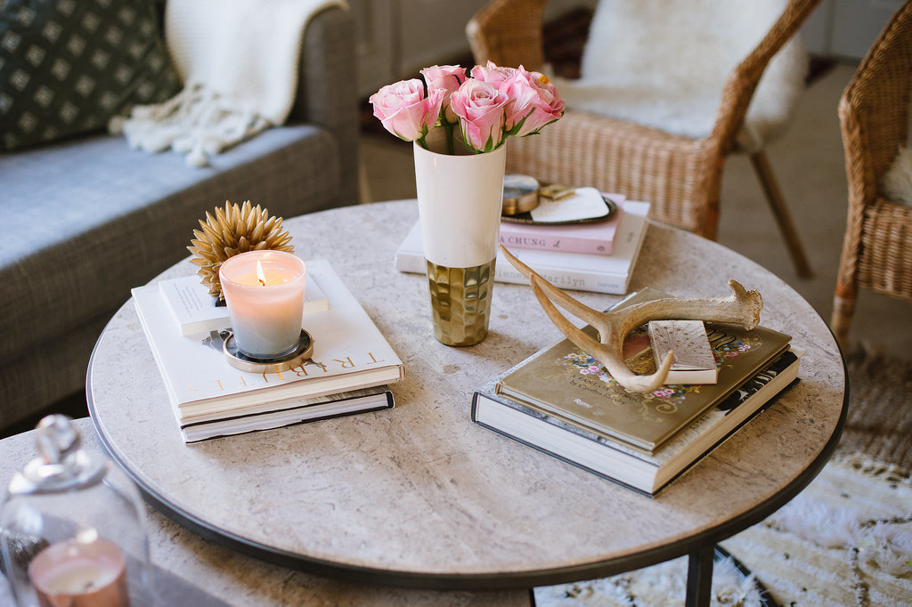 Nesting coffee tables are perfect for entertaining. They're also a great solution in small spaces since you can tuck one under the other. Antlers are a chic touch when used as an accent piece rather than on the wall.  Source: Natalie Franke