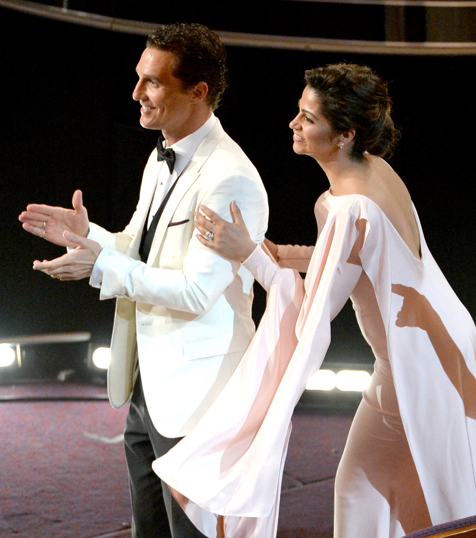 Matthew McConaughey and Camila Alves stood up to clap during the Oscars.