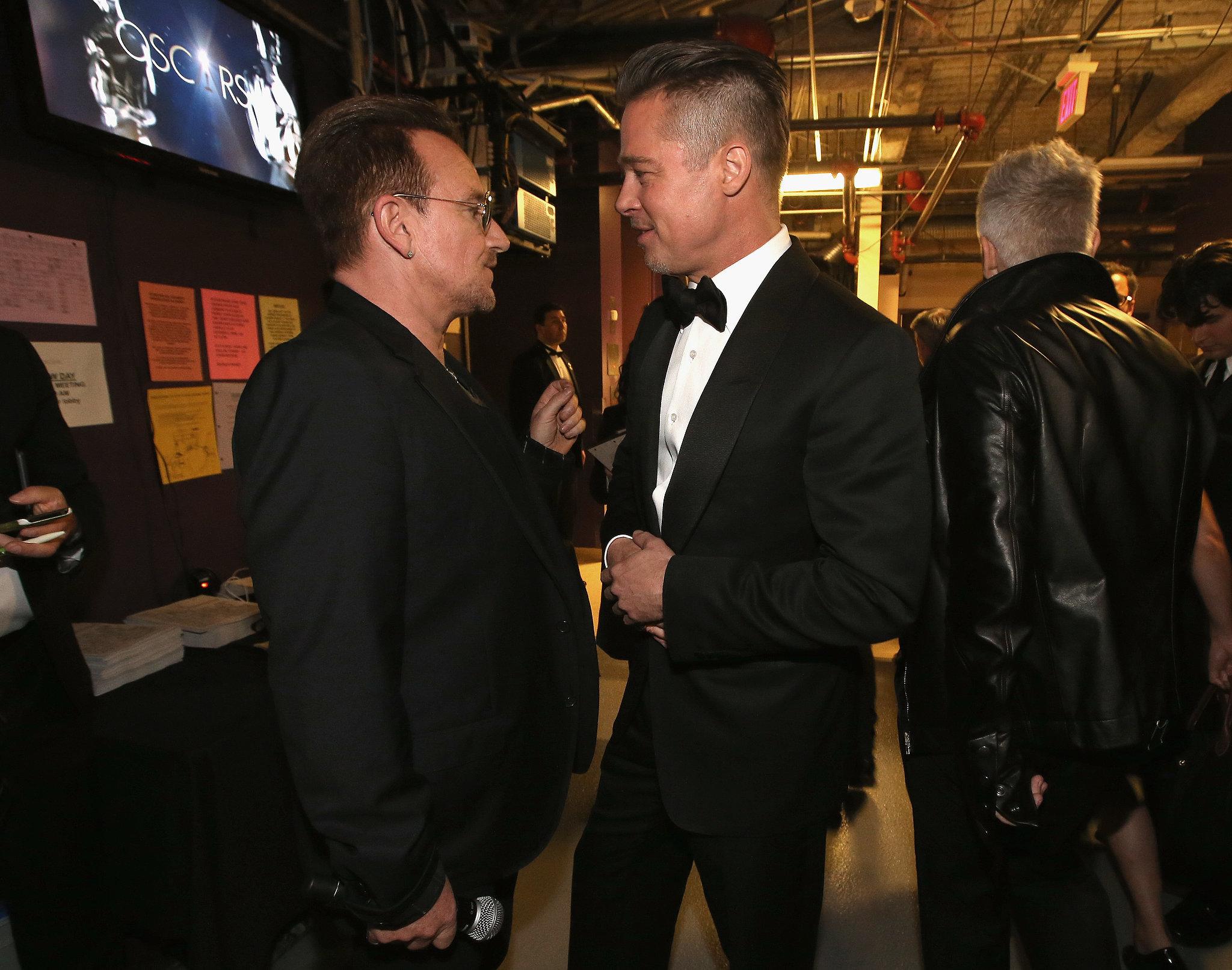 Brad Pitt and Bono talked backstage before U2 performed.