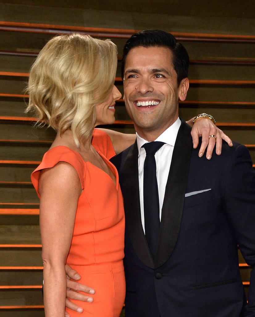Kelly Ripa cuddled up to Mark Consuelos at the Vanity Fair Oscars party.