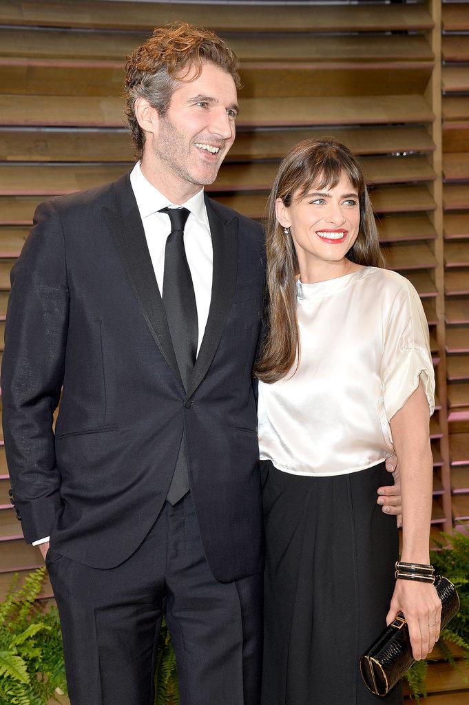 Amanda Peet flashed a big grin alongside David Benioff at the Vanity Fair Oscars party.