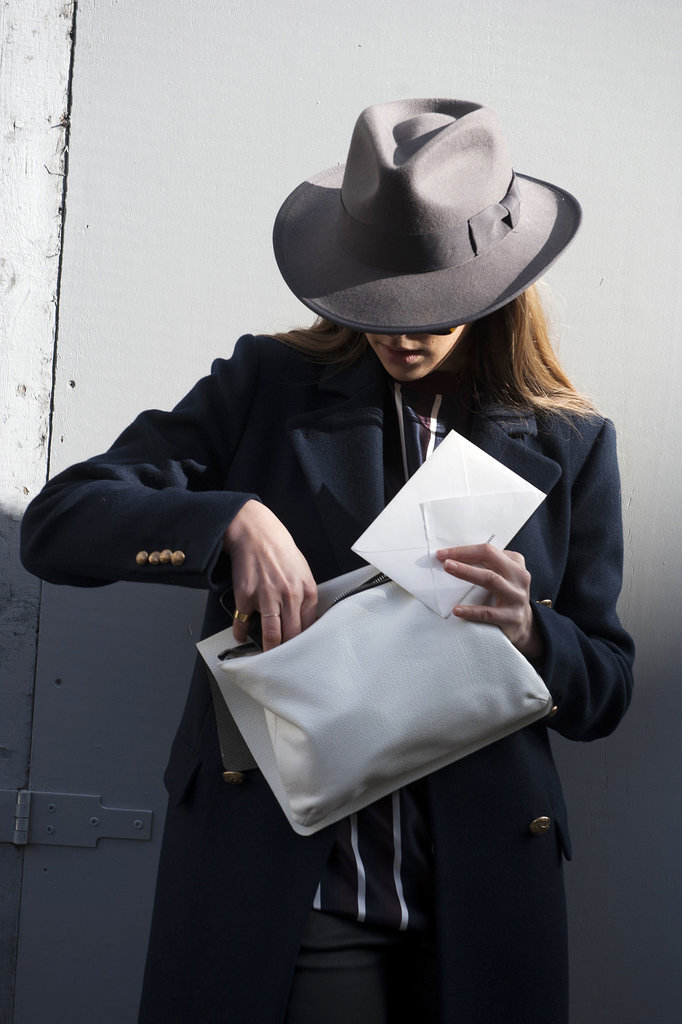 We don't even need to see the rest of the outfit, this hat and clutch get our vote.
