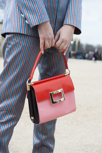 A menswear-inspired suit got finished with a totally ladylike bag.