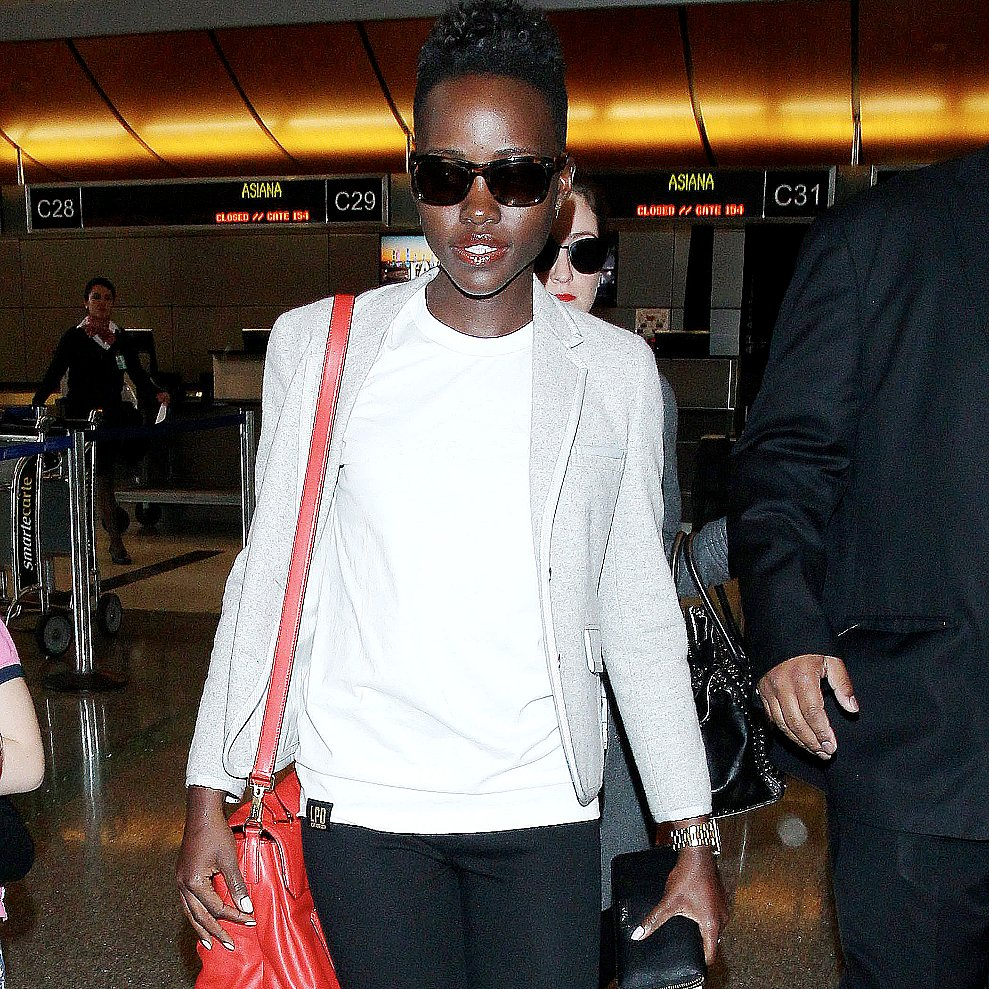 Lupita Nyong'o at Airport With Red Miu Miu Bag