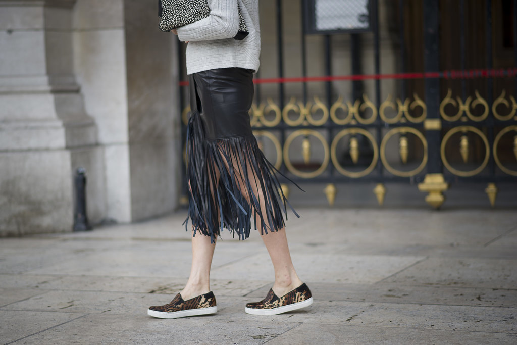 Eva Chen's fringed hemline showed off a pair of sporty slip-ons.