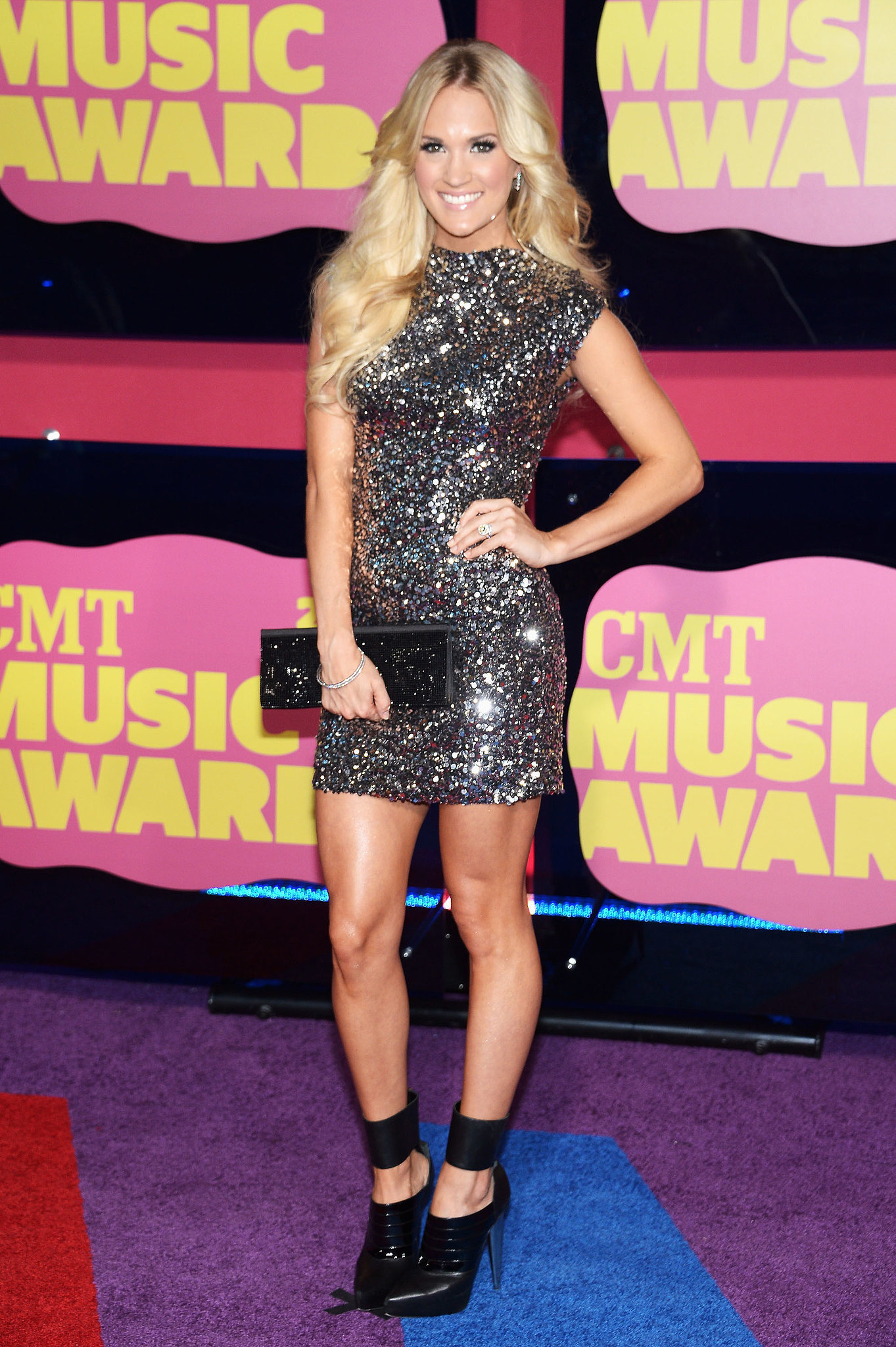 The singer juxtaposed her flashy Randi Rahm mini with edgy ankle-cuff Gio Diev booties at the 2012 CMT Music Awards.