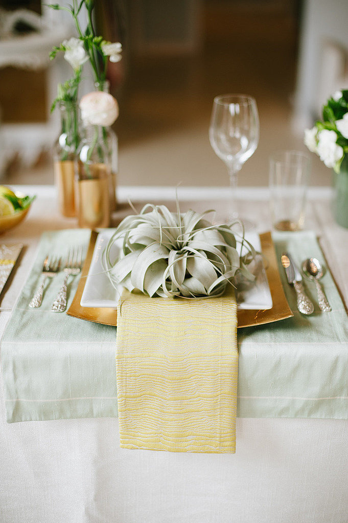 This place setting is a fresh way to try the succulent trend and incorporate green hues. Photo by  Christine Sargologos Photography via Style Me Pretty