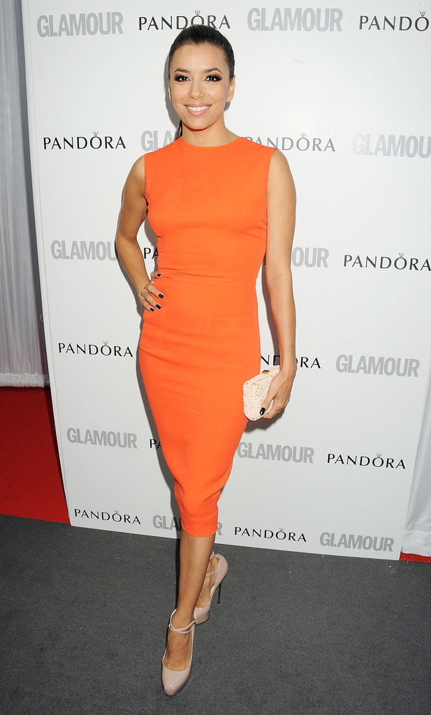 Eva's Brian Atwood patent ankle-strap pumps got a jolt of bold via her orange Victoria Beckham sheath dress for Glamour's 2012 Women of the Year Awards in London.