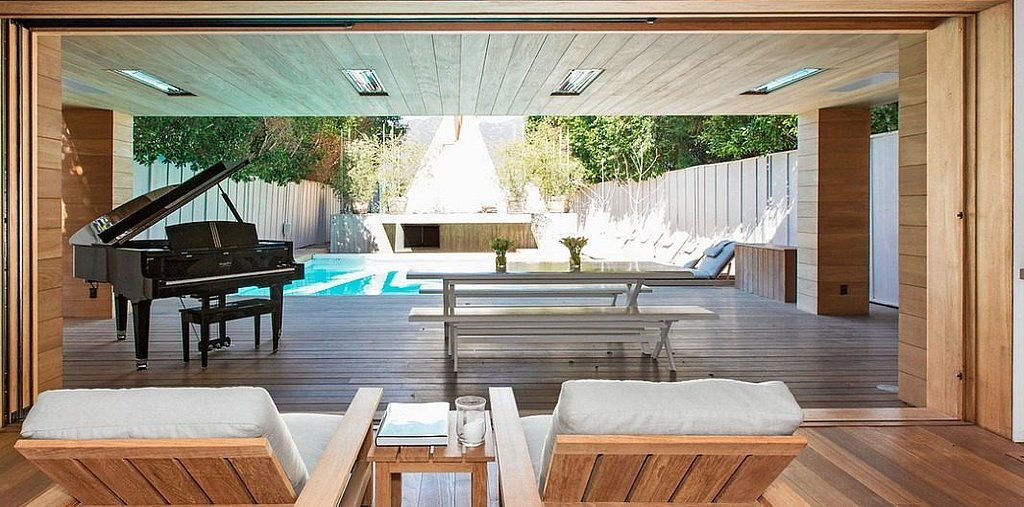 Woodwork that seamlessly continues into the backyard creates an open flow — ideal for Malibu living.  Source: Chris Cortazzo