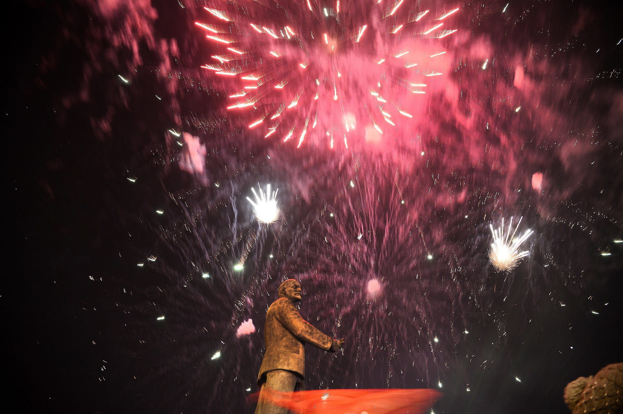 Fireworks exploded behind the monument of Soviet Union founder Vladimir Lenin in the Crimean capital of Simferopol Sunday night, after preliminary results showed a landslide for the pro-Russia side.