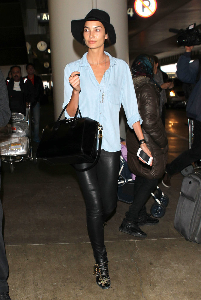It was part rock star, part Nashville lady for Lily Aldridge, who emerged from the airport in leather pants, studded ankle boots, and a chambray top.