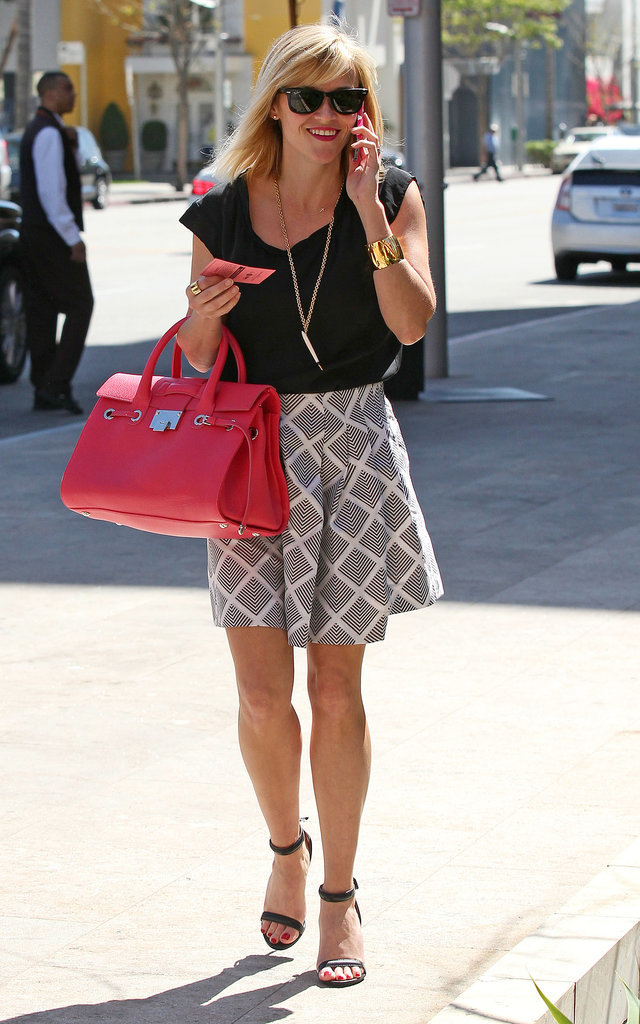 Reese Witherspoon in Graphic Skirt and Red Jimmy Choo Bag