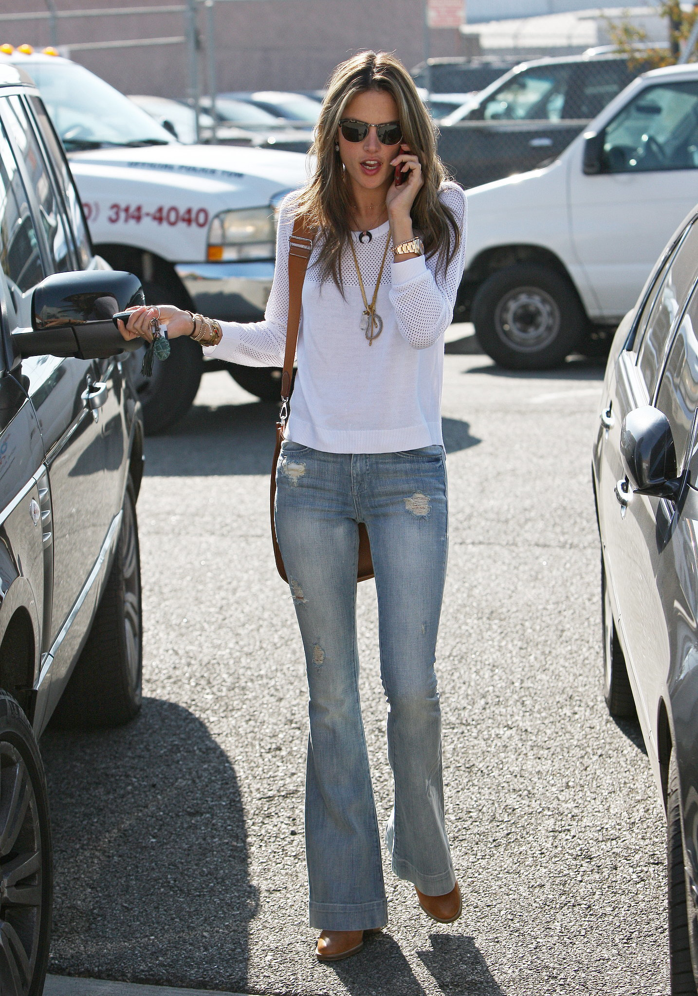 Alessandra picked a pair of light denim flares and a thin