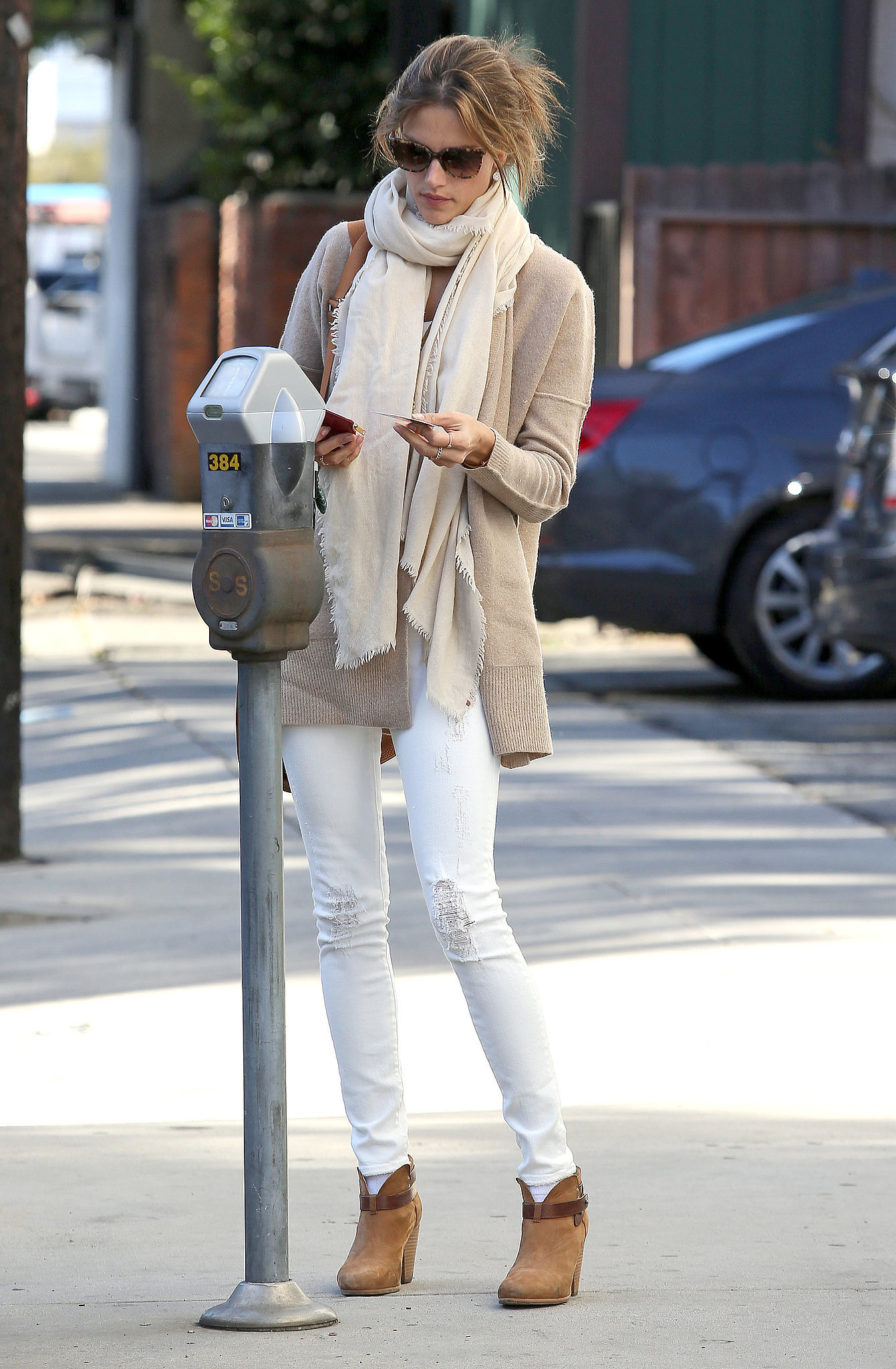 White's not just for Summer months anymore! She put together a neutral-hued outfit anchored with distressed jeans earlier this Winter.