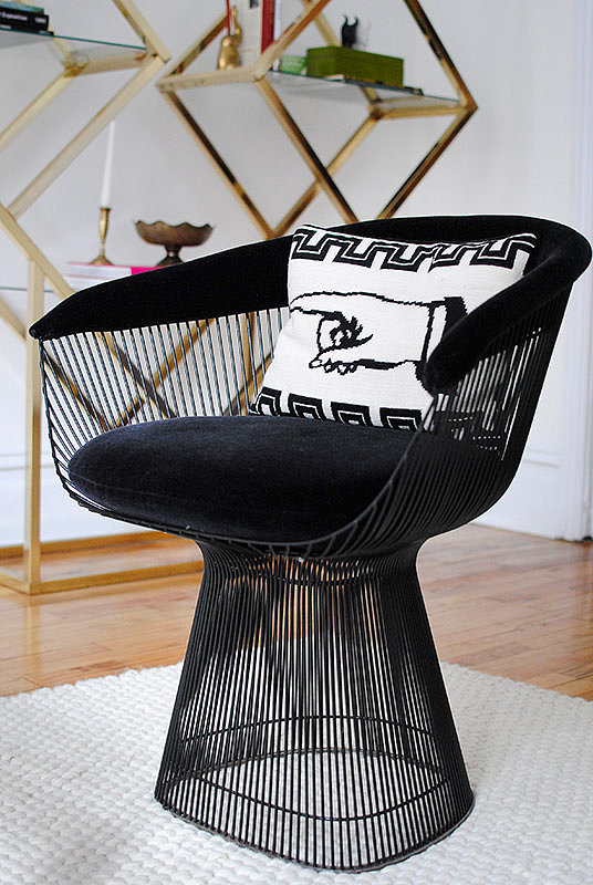 This refurbished, black velvet Knoll Platner chair is one of Casey's favorite finds. Source: Homepolish