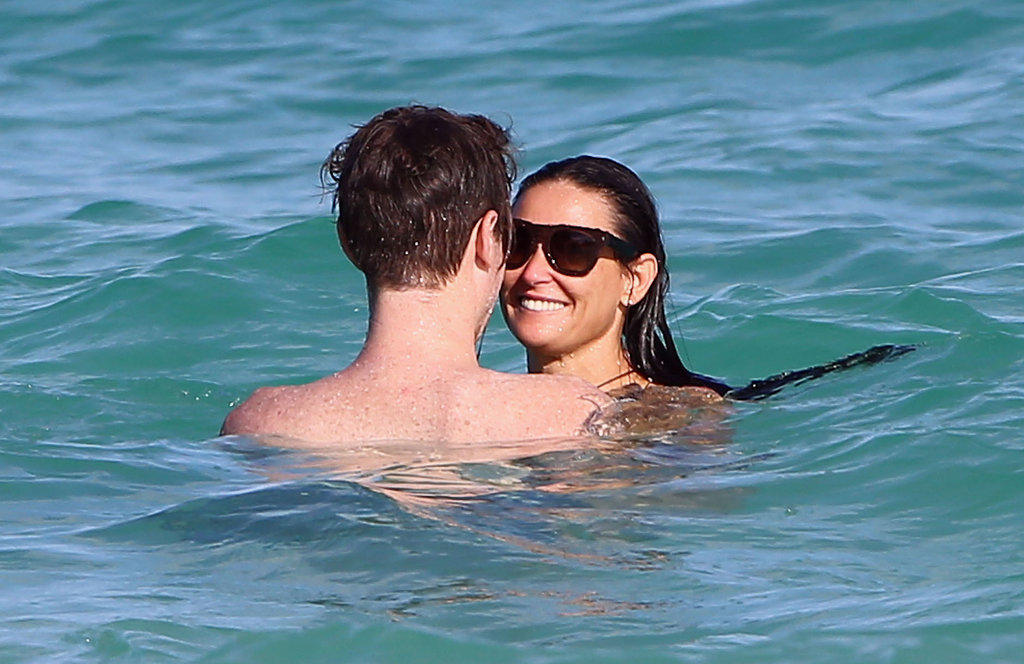 Demi Moore kicked off 2014 with a new guy, 27-year-old drummer Sean Friday, in Mexico.