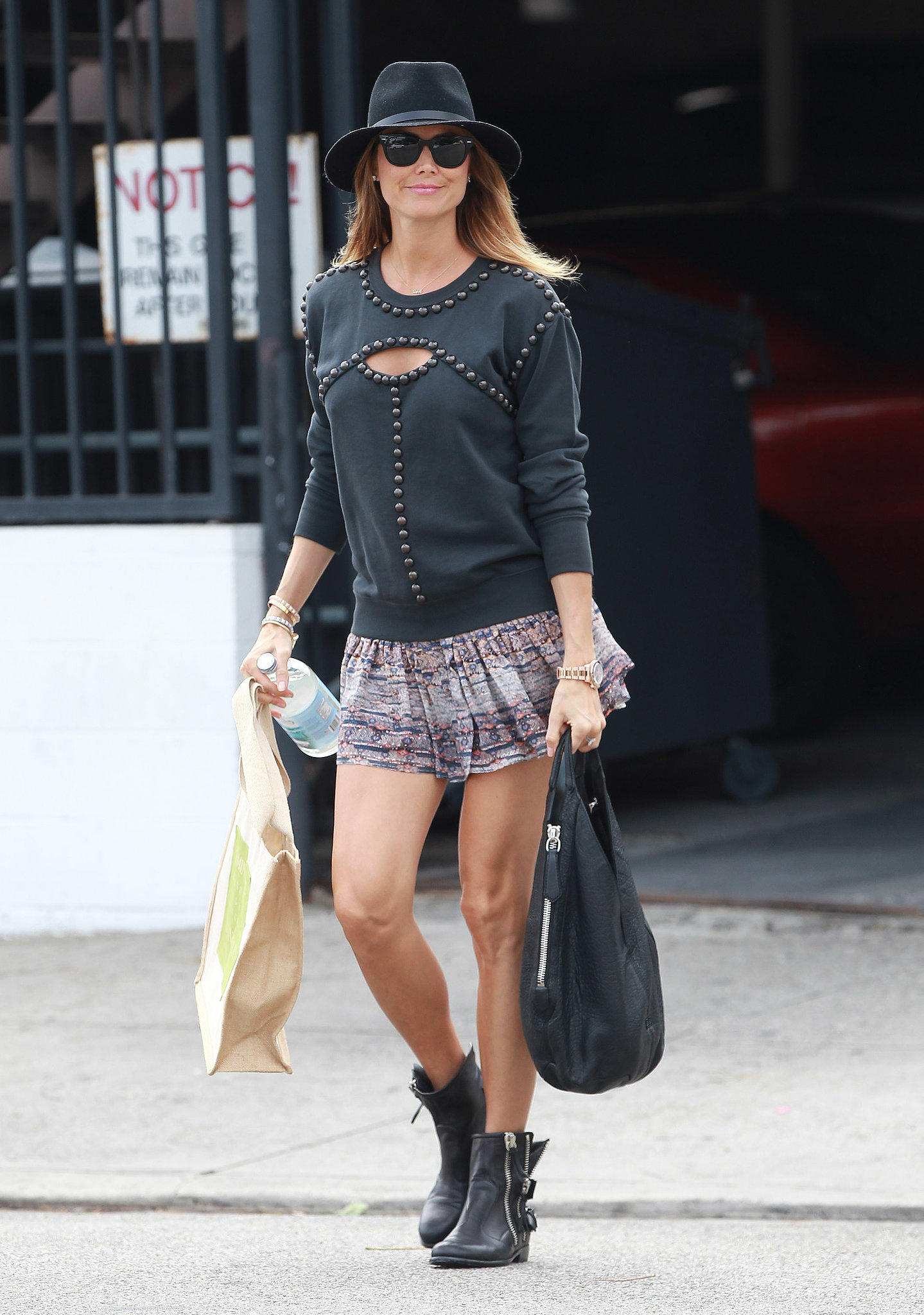 Stacy Keibler added a cutout Isabel Marant sweatshirt to a ruffled Isabel Marant miniskirt, then finished with motorcycle boots and a hat for a cool-girl twist. Who says maternity style can't be sexy?  Just scroll on to shop some of Stacy's exact pieces and more to replicate her breezy, boho outfit.