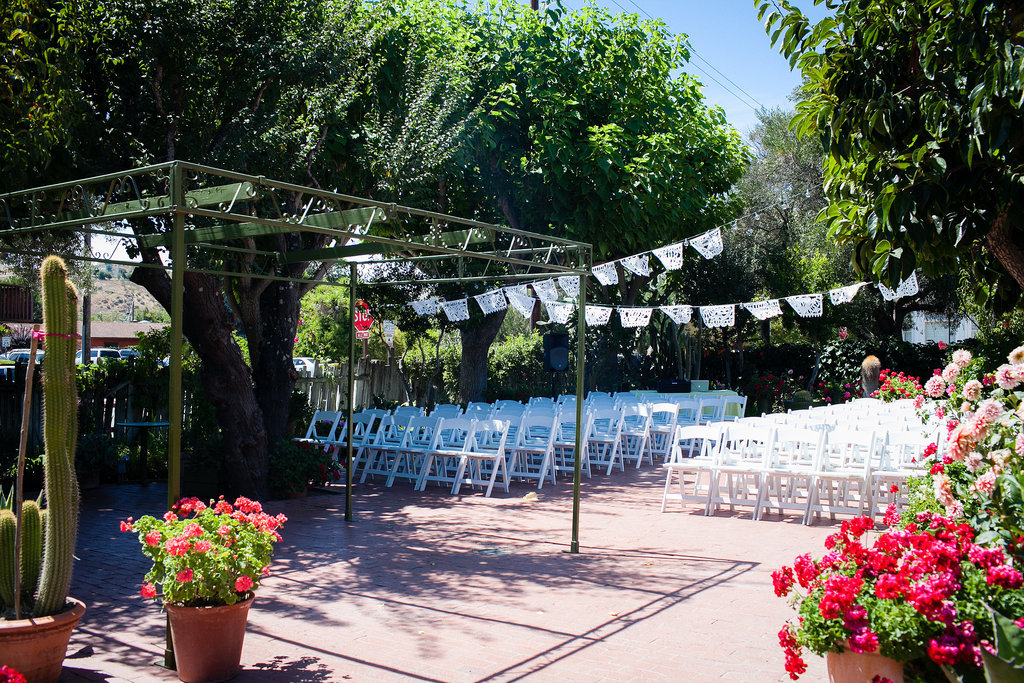 "Where did the wedding take place, and why did you choose it? ""We stumbled across San Juan Bautista the Summer before our wedding, when we were camping nearby with friends. One of them mentioned the mission there, so we stopped by and treated ourselves to brunch at Jardines de San Juan, which happened to have a beautiful back garden in addition to the great food (and margaritas!). It popped up on a list of gay-friendly venues when we started our search not long after that, so we knew it was meant to be. We even got to take our postceremony shots on the mission grounds!"" Photo by G Aranow Photography"