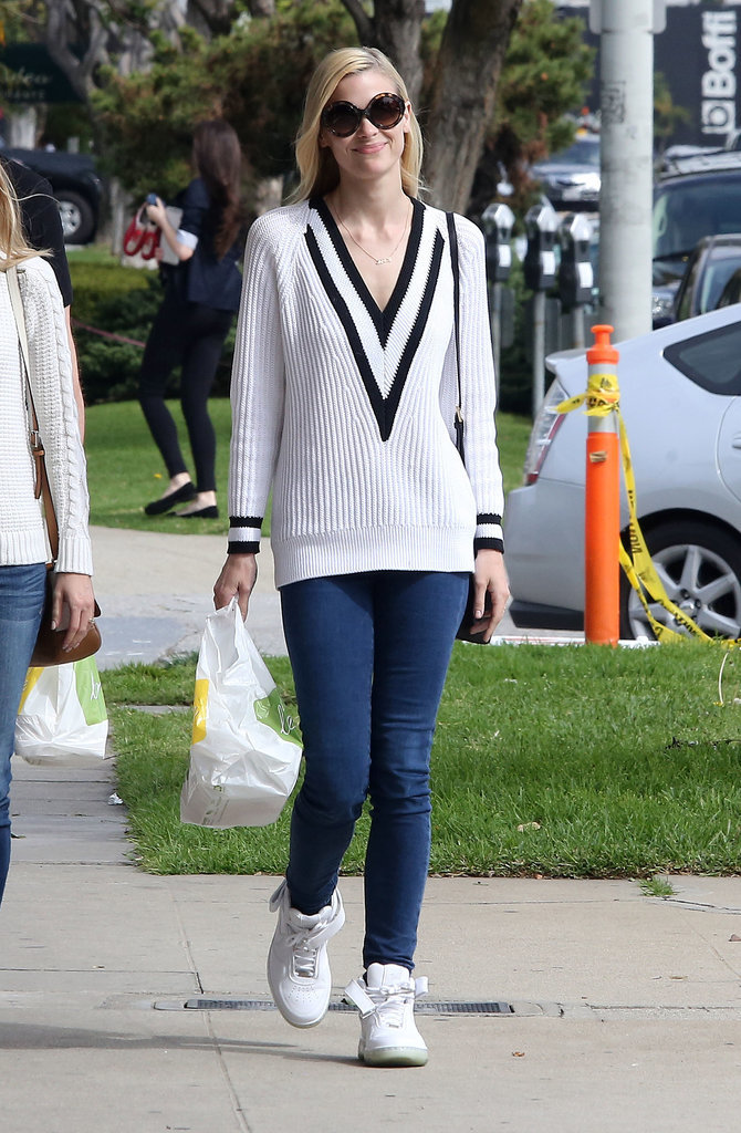 Jaime King's preppy-cool outfit is centered around her sporty Rag & Bone sweater.