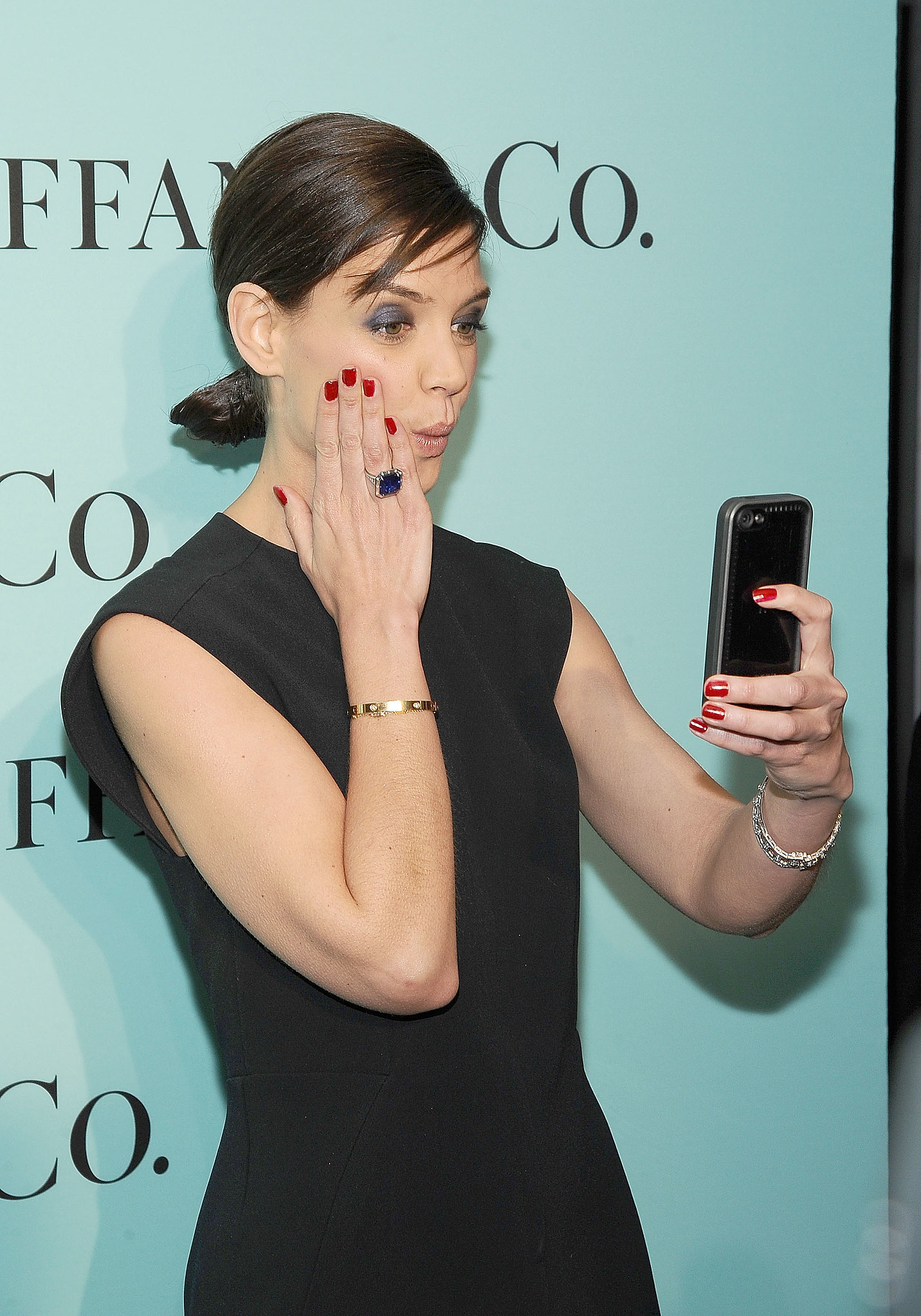 In April 2014, Katie Holmes snapped a selfie at an event in NYC.