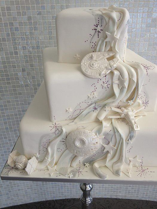 Is this not the most epic Star Wars wedding cake you've ever seen? Not to mention it's so pretty, too!  Source: Imgur user ticktockfucktheclock