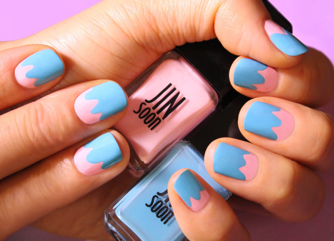 File and shape your nails in a natural square or roundish shape. Apply a base coat like JINsoon Power Coat ($18). Apply JINsoon Dolly Pink ($18) on the entire nail bed. Apply JINsoon Poppy Blue ($18) about two-thirds of the way from the top of the nail, closer to the cuticle area, creating a few curved lines and filling in to the tip of the nail. Finish with a high-shine top coat like JINsoon Top Gloss ($18).