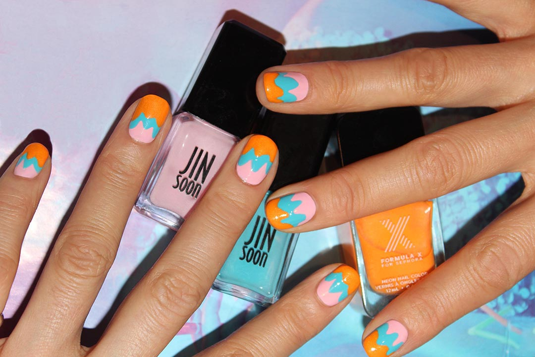 File and shape your nails in a natural square or roundish shape. Apply a base coat like JINsoon Power Coat ($18). Apply JINsoon Dolly Pink ($18) on the entire nail bed. Apply JINsoon Poppy Blue ($18) about two-thirds of the way from the top of the nail, closer to the cuticle area, creating a few curved lines and filling in to the tip of the nail. For a three-toned look, apply Formula X for Sephora Seismic ($11) over Poppy Blue in the same manner as you applied Poppy Blue. Finish with a high-shine top coat like JINsoon Top Gloss ($18).