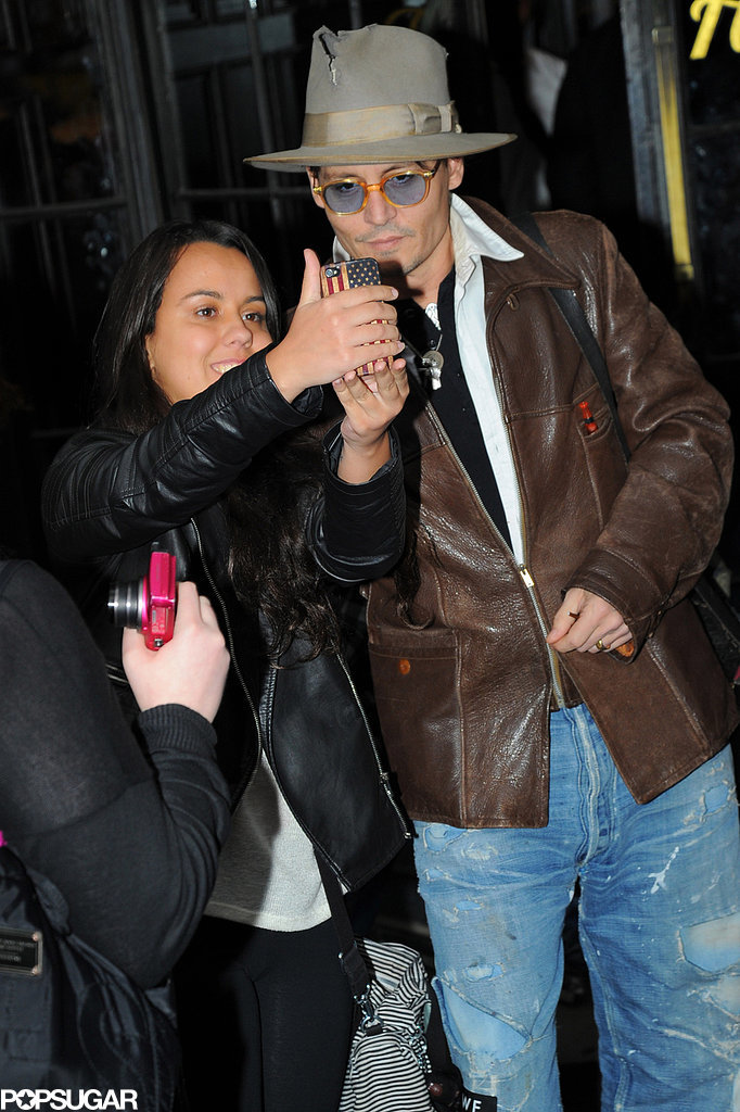 Johnny Depp stopped for a photo while out in NYC in April 2014.
