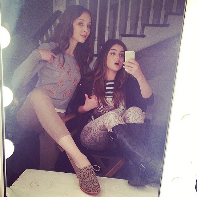 Pretty Little Liars stars Troian Bellisario and Lucy Hale got goofy on set. Source: Instagram user sleepinthegardn