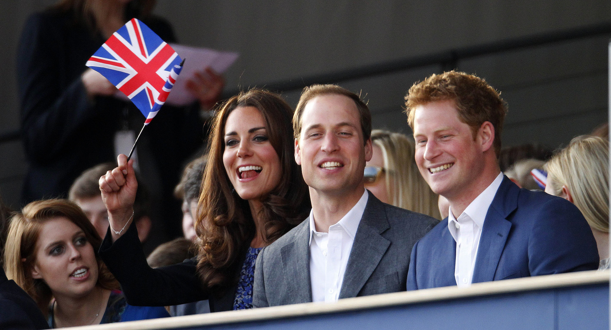 Kate Middleton and Prince William cheered during the Diamond Jubilee Concert in London with Prince Harry and Princess Beatrice in June 2012.