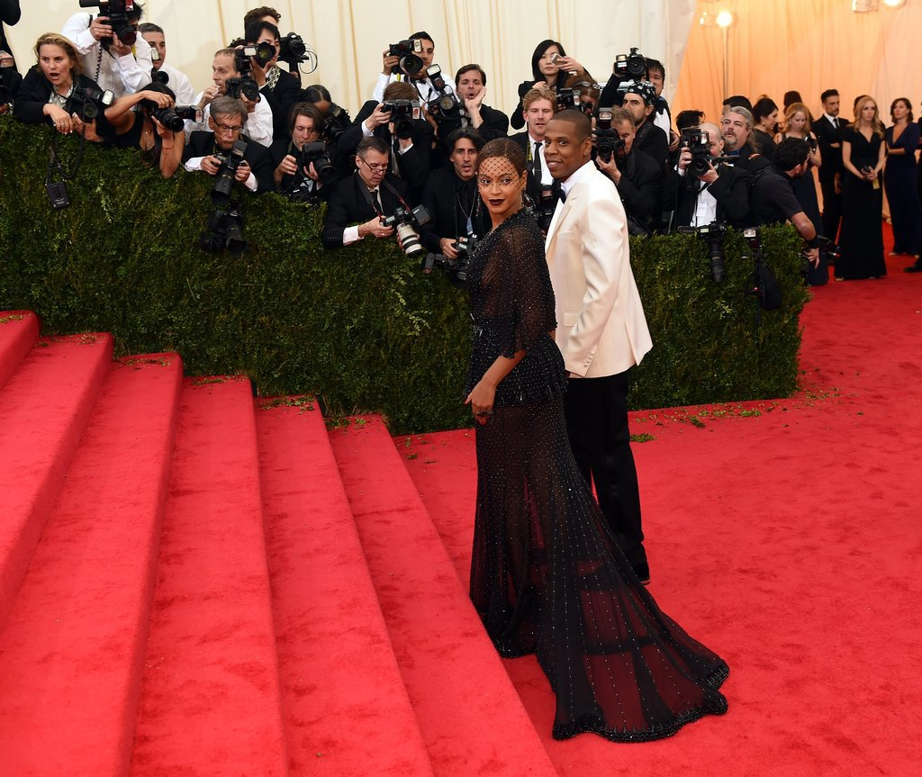 Beyoncé and Jay Z paused before the grand staircase.