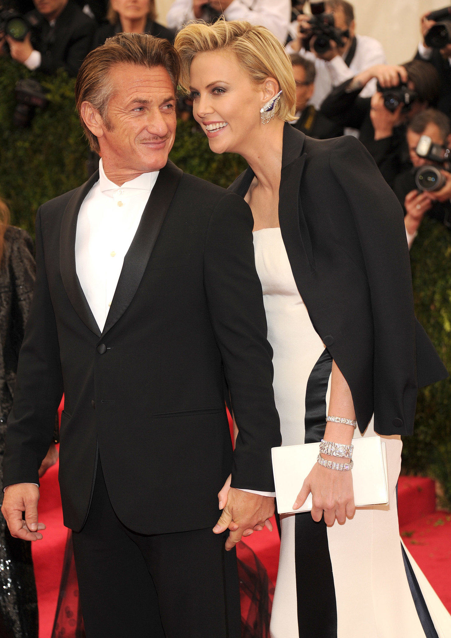 Charlize Theron stuck close to boyfriend Sean Penn on her way into the bash.