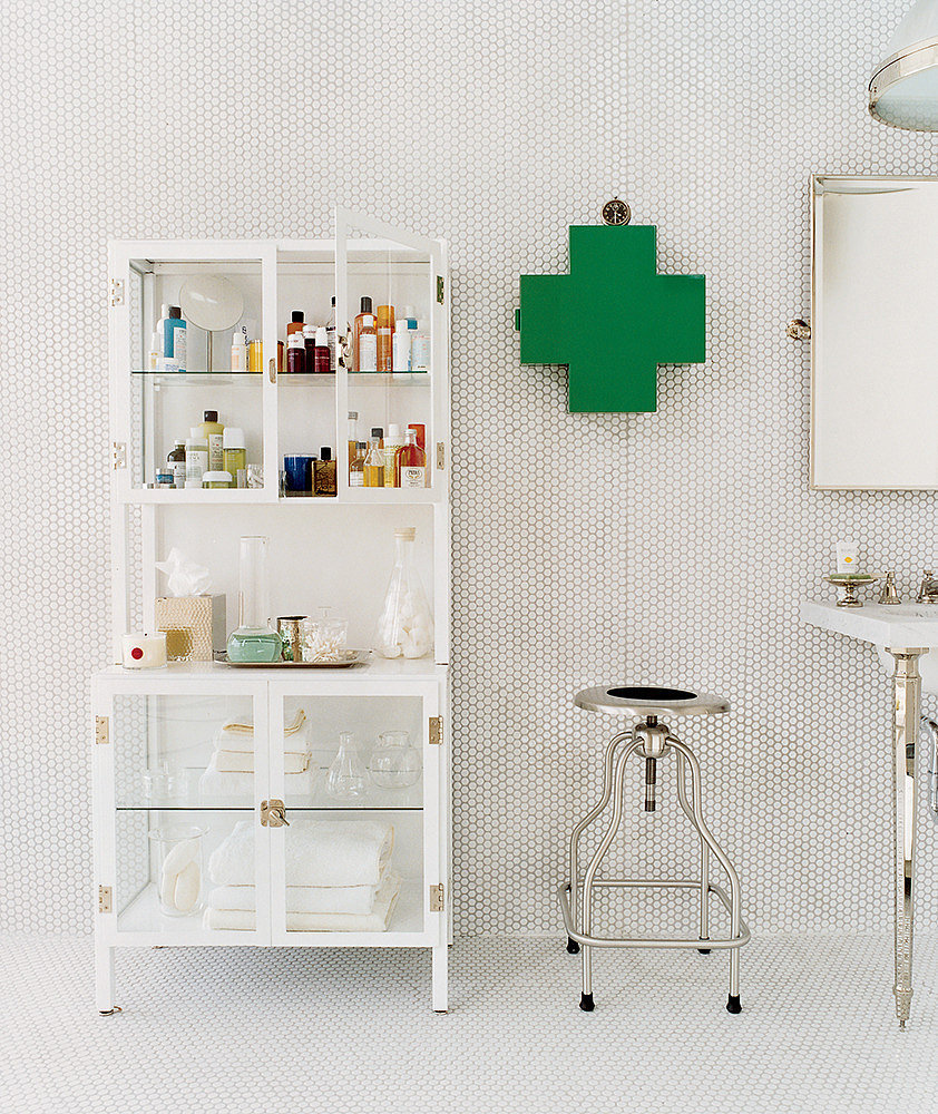 An affordable alternative to custom built-ins, this cupboard does the trick! Since it holds everything from towels to toiletries, no additional storage is needed!  Source: Domino