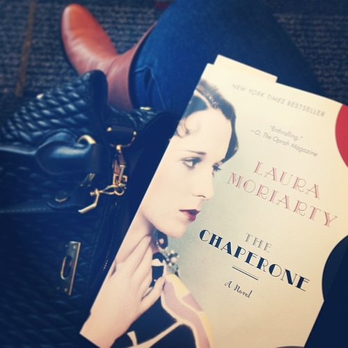 "Lauramariemeyers snapped a photo of Laura Moriarty's The Chaperone, adding, ""Been saving this one for an airport day, and already obsessed three chapters in!"""