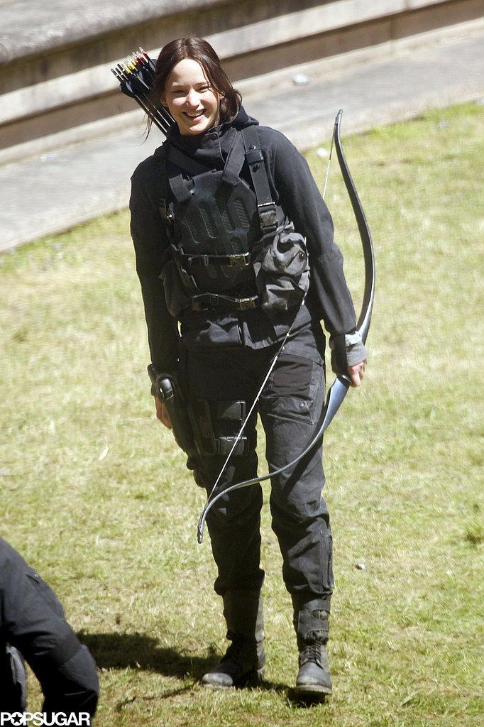 Jennifer Lawrence flashed a smile on the Hunger Games: Mockingjay Part II set in Paris on Thursday.