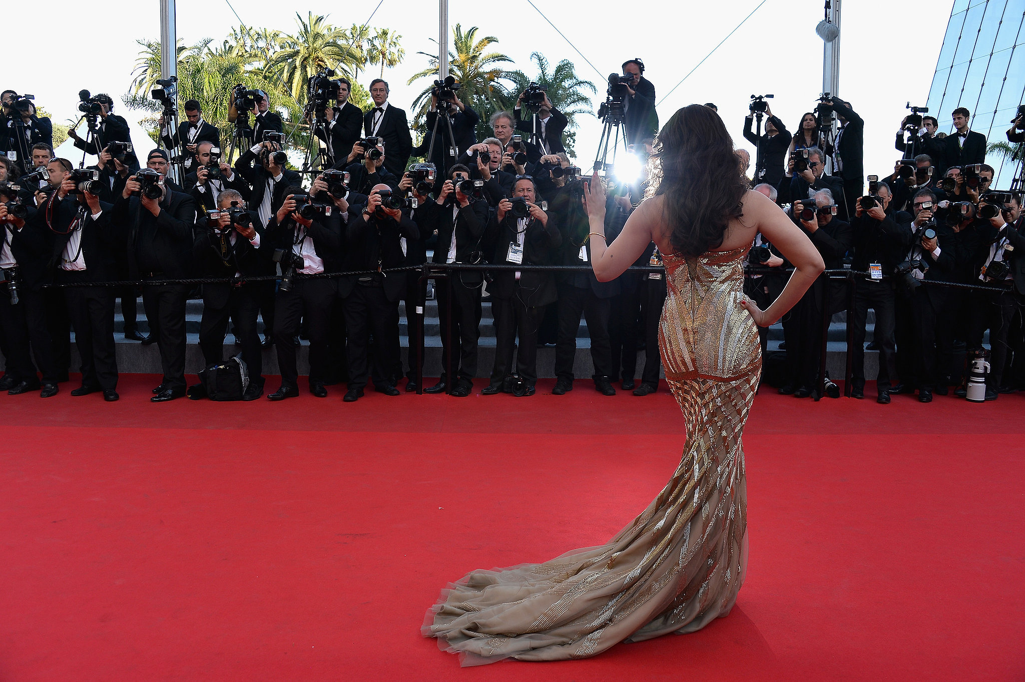 Actress Aishwarya Rai waved to fans and photographers at the premiere of Two Days, One Night.