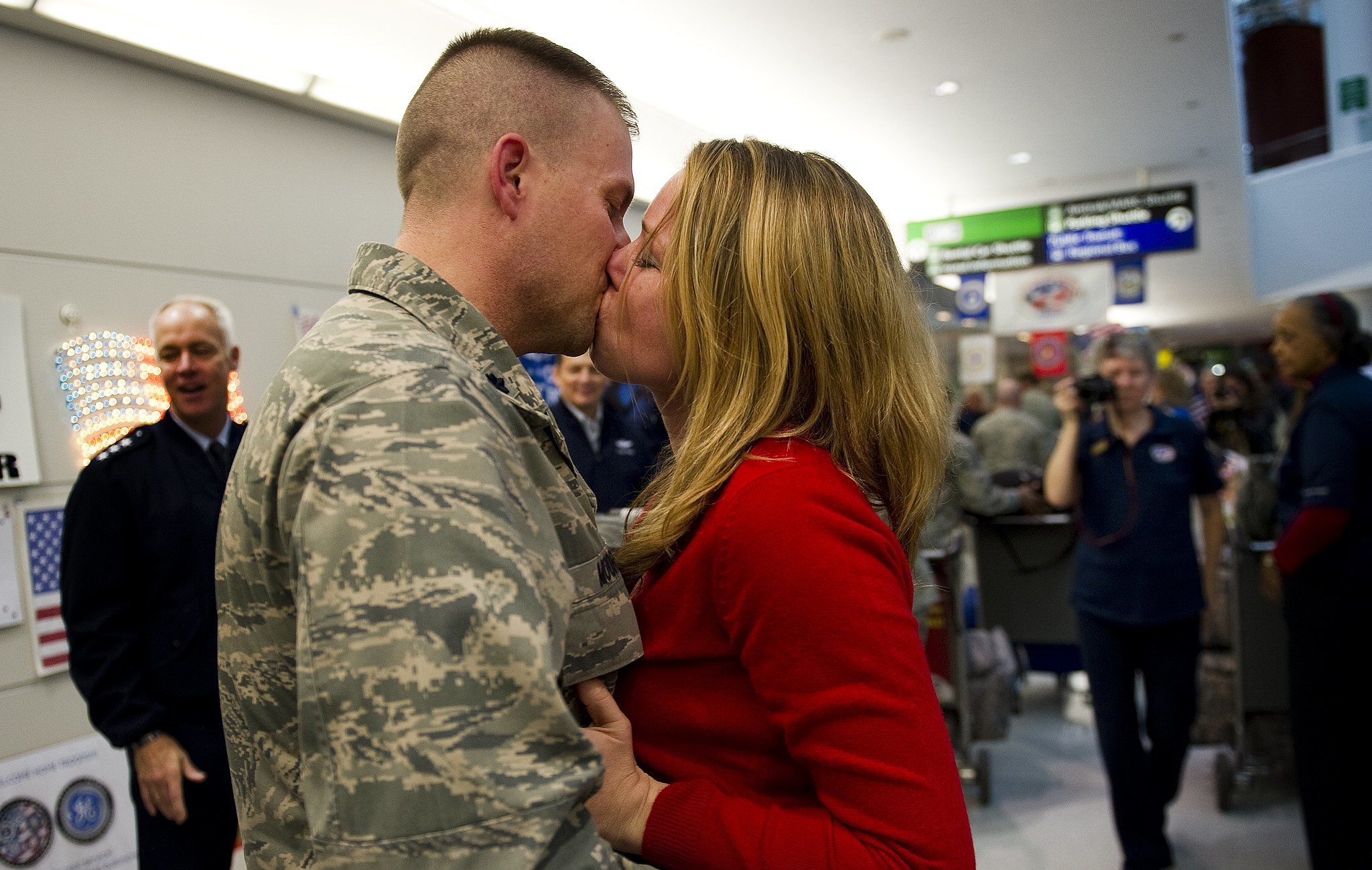 Major Steve Moore kissed his wife, Emily, when he arrived home at Baltimore Washington International Airport in Baltimore on Dec. 20, 2011. He was one of more than 300 Airmen, the last Air Force personnel to return home from Iraq.