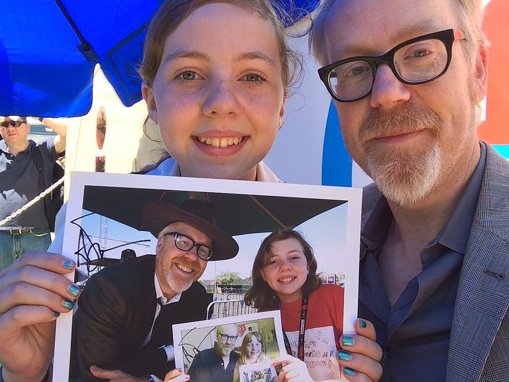 """""""Adam Savage tweeted this cool photo. 'This is the awesome Silvia. She's come to Maker Faire and taken a photo with me holding last year's pic for 5 years!'"""" Source: Reddit user Randyy1 via Imgur"""