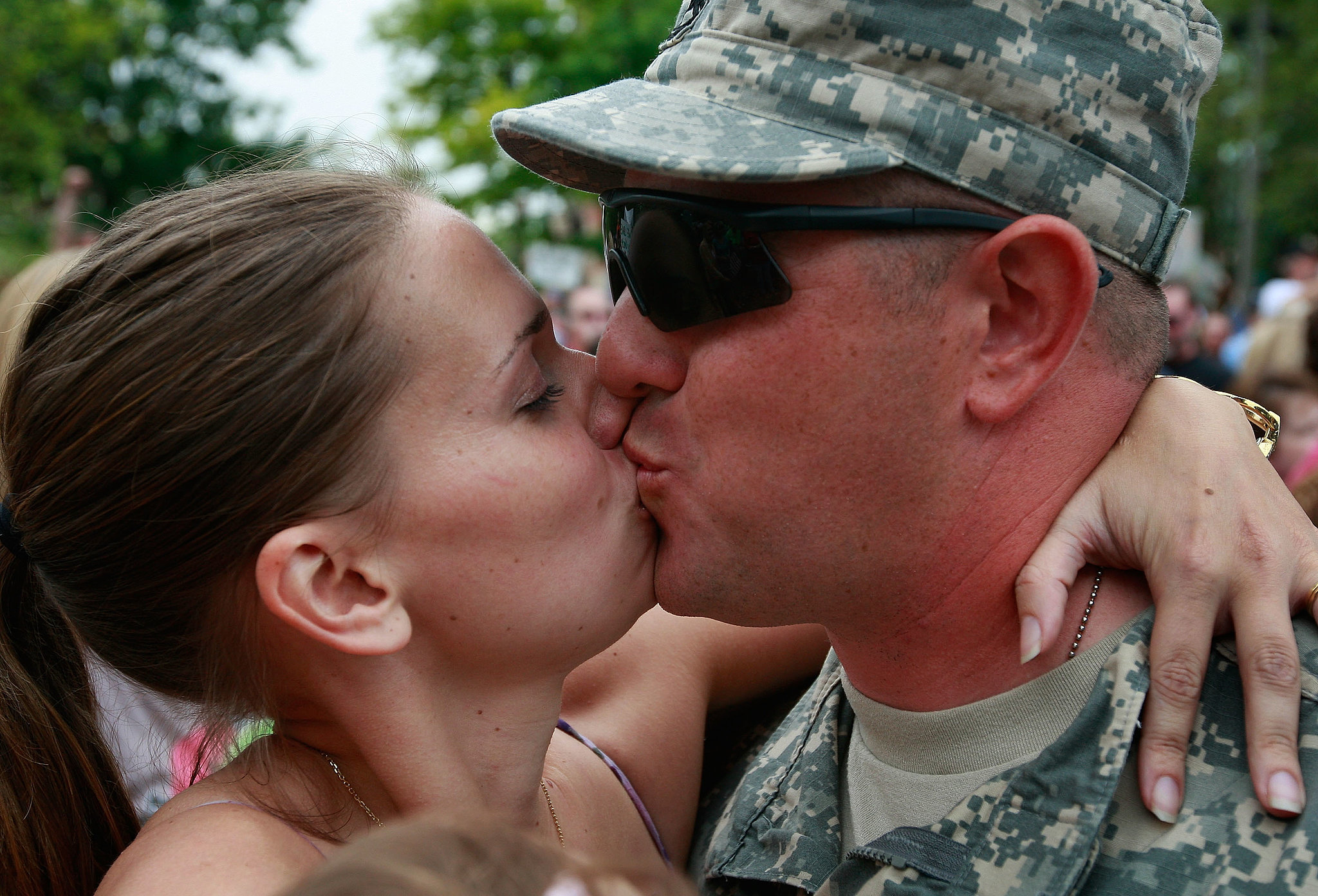 Matthew Burleson of the Illinois Army National Guard is welcomed home with a kiss from his wife, Nadine, in 2009.
