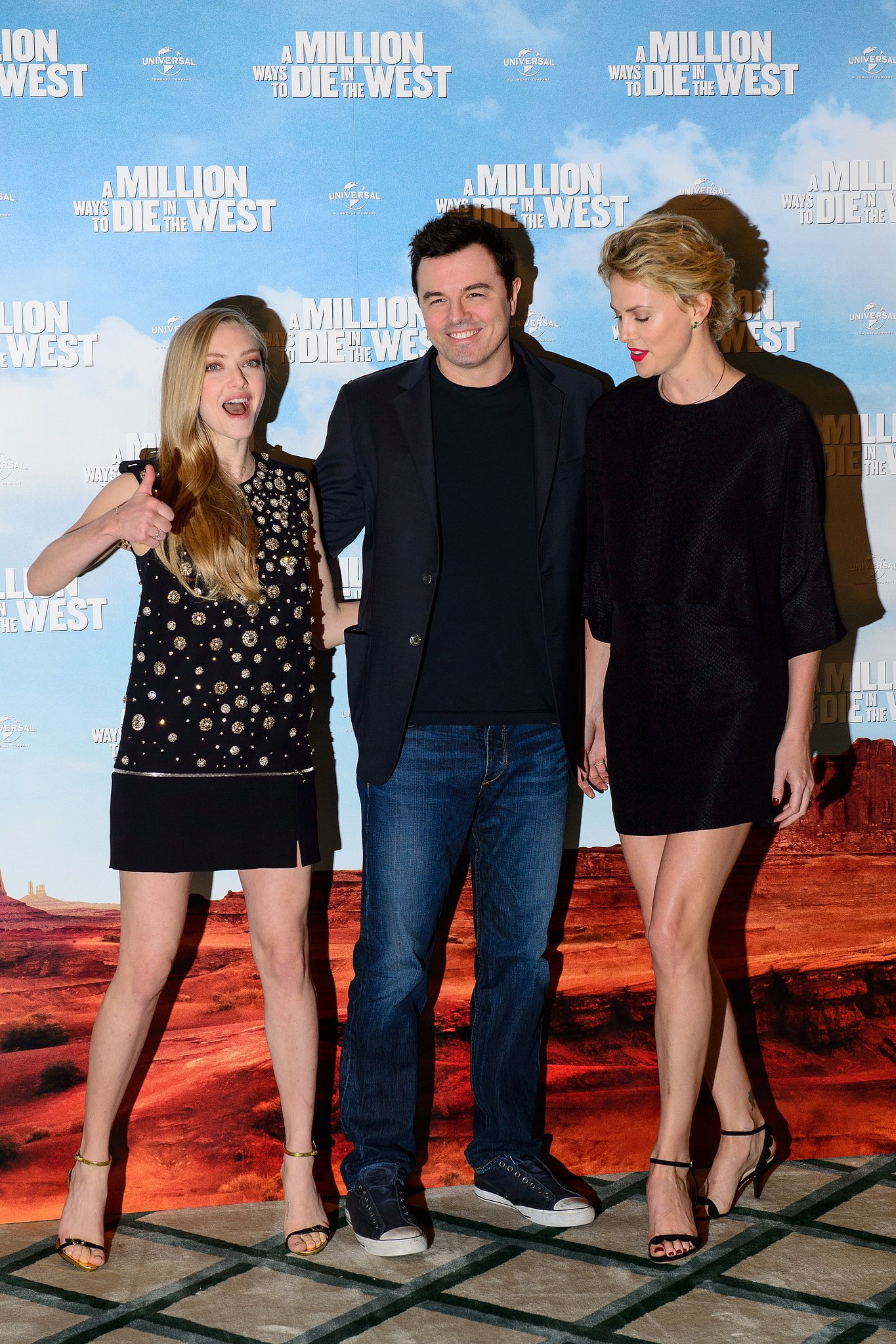 Amanda Seyfried got goofy at the A Million Ways to Die in the West premiere with costars Seth MacFarlane and Charlize Theron in London on Tuesday.