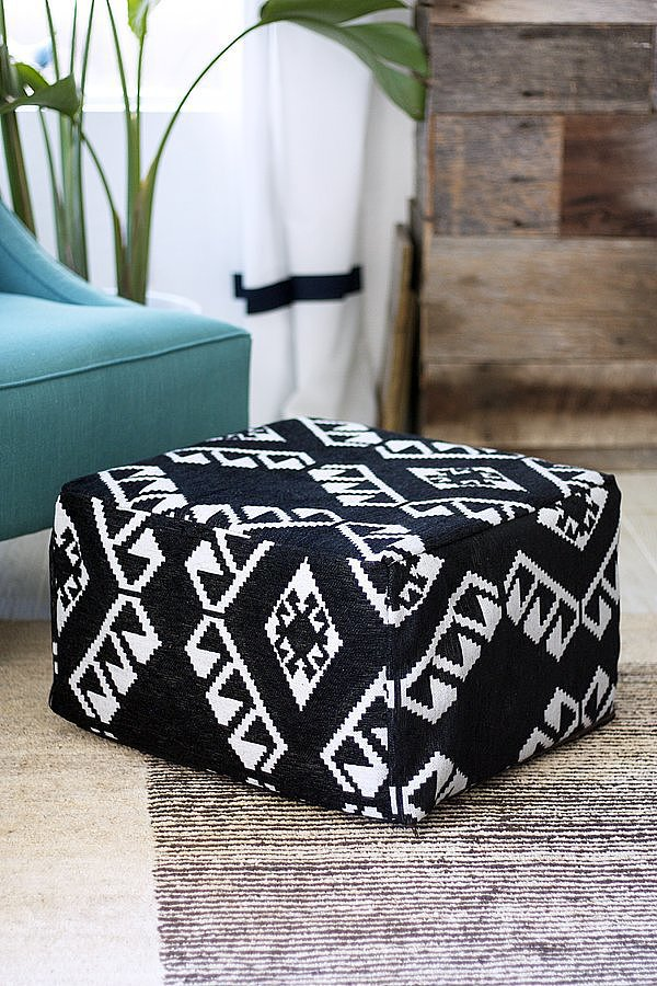 A basic Ikea cube becomes an on-trend pouf with just one yard of fabric.  Source: Kristi Murphy