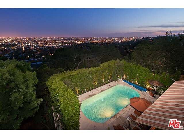 Another view of the pool and city at night. Source: Coldwell Banker